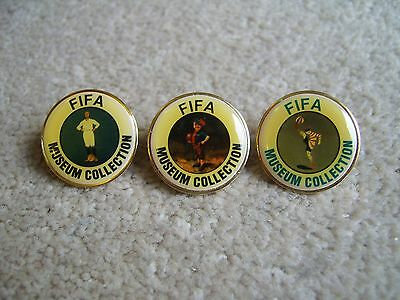 3 FIFA Museum Collection metal and coated enamel badges / pins
