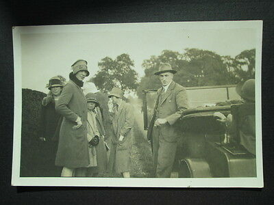 GROUP OF PEOPLE NEXT TO VINTAGE CAR, TWENTIES FASHION -REAL PHOTO POSTCARD 1920s