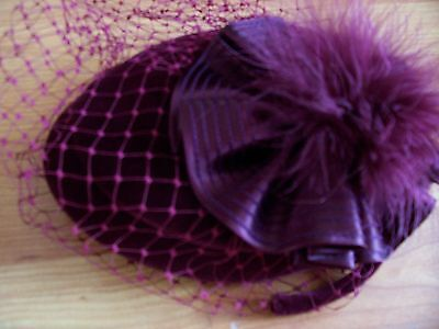1980's burgundy small wedding hat with feathers & netting from Kangol Design