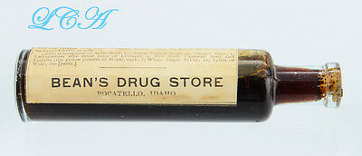 OLD west POCATELLO IDAHO antique bottle BEAN'S DRUG STORE w/label AND contents