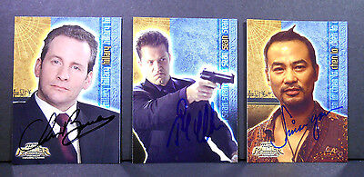 Simon Yam, Barrie, Schweiger Signed Tomb Raider Cards (Lot 177)