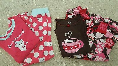 Gymboree and Carter's pajama sets size 5T hot cocoa fleece and love to be snug.