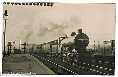Real Photo Postcard of Train passing through Hornsey Railway Station