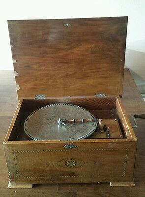 An Antique Walnut cased  disc playing music box and discs Circa 1890.