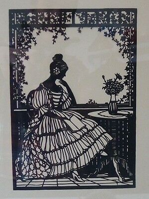 Vintage folk art silhouette paper hand cut out picture of a crinoline lady