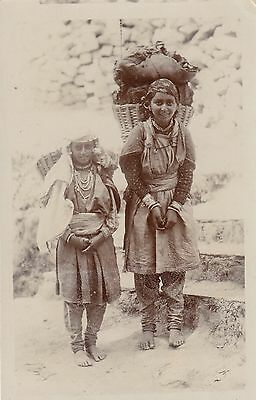 India, 2 Young Girls  Charcoal Carriers Real Photo Postcard message on reverse.