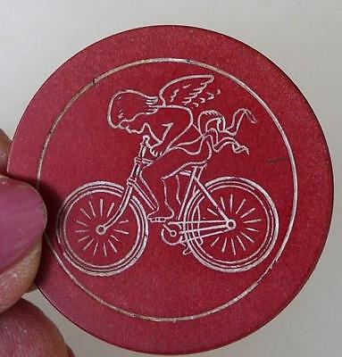 RARE ! Early 1900's  Engraved, Clay Poker Chip, Angel With Wings, Riding Bicycle