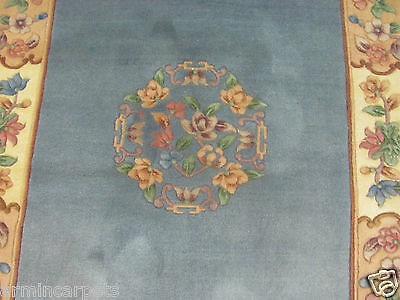 AN ATTRACTIVE OLD HANDMADE CHINESE ORIENTAL RUG (183 x 122 cm)