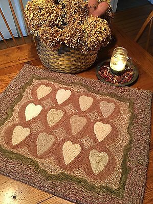 """Primitive Hooked Rug Pattern On Monks """"Antique Adaptations: 12 Hearts"""""""