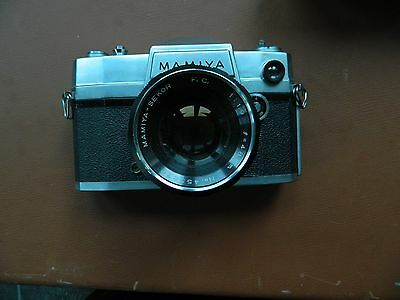 Mamiya  SLR Camera with Petri 1:9 48mm Lens.