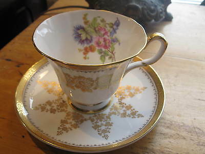 Vintage Tuscan  Footed  Tea Cup And Saucer.  Rich Gold Trim ,flowers  A1
