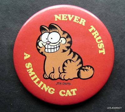 "Never Trust A Smiling Cat Garfield the Cat Jim Davis Pin  2 1/4"" Diameter"