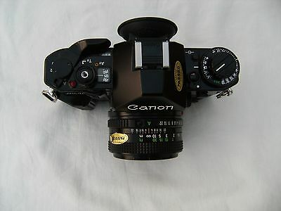 Canon A-1 35mm SLR Film Camera with 50mm lens Kit