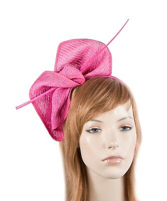 Hot Pink fascinator with long feather by Max Alexander. RRP: $79.95