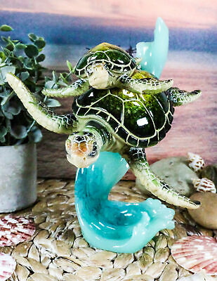 Ocean giant sea turtle with hatchling baby swimming over coral wave ocean giant sea turtle with hatchling baby swimming over coral wave figurine publicscrutiny Image collections