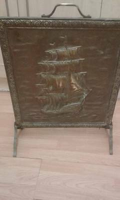 Vintage 'brass' fire screen with ship.