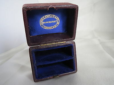 Leather covered wooden box with fitted velvet interior- James A. Sinclair & Co