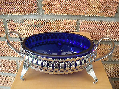 Cobalt Blue Glass Sugar Bowl on a Chrome Stand supported by Three Feet.