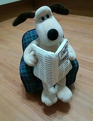 gromit sitting on an armchair soft toy