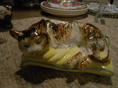 early majolica recumbent cat L 7 inches W 4.5 inches and H 3.75 inches
