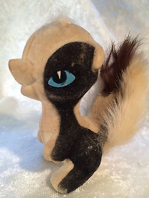 Vintage Flocked Skunk Figurine