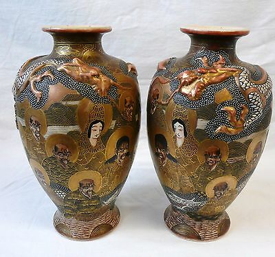 Pair of Japanese Satsuma '1000 Faces' Immortals with Embossed Dragon' Vases.