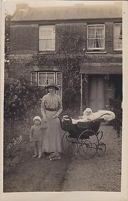 Original Vintage Real Photo Postcard. Mum Outside House With Children