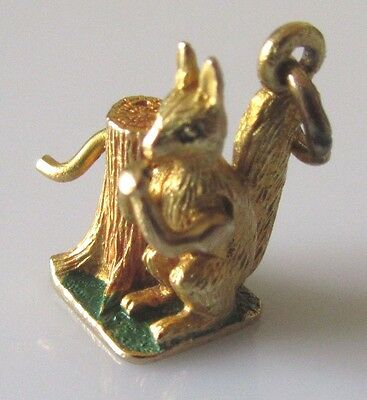 Vintage 9ct yellow gold enamelled squirrel eating nuts charm (moves).