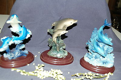 Set Of Three Resin Dolphin Figurines On Wood Tone Bases - Collectable Figurine