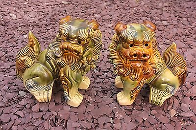 Vintage Chinese Lion Dogs..8 inches high..ceramic..