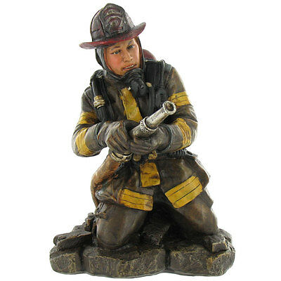 Polyresin Kneeling Firefighter figurine with Hose and Nozzle