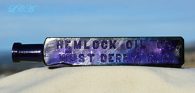 Desirable looking PURE purple HEMLOCK OIL antique bottle from DERRY N Hampshire