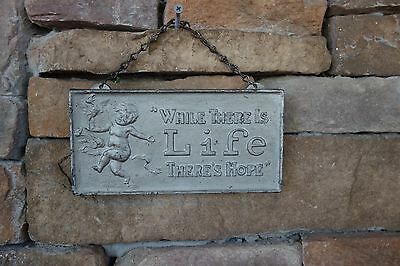 antique cast iron sign raised letters ( while theres life theres hope)