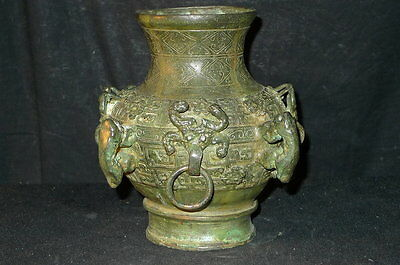- chinese Warring States bronze four beast head vessel