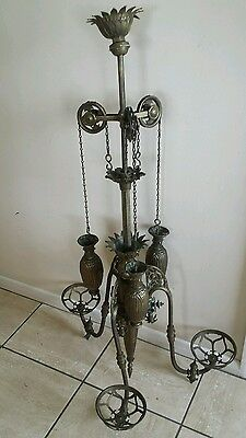 A lovely Astetic movement Brass 3 branch weighted pully ceiling lamp.Circa 1860