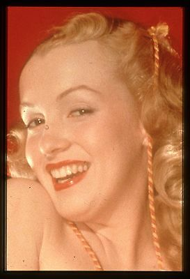 35mm color transparency/slide photo of a young marilyn monroe taken in 1949.