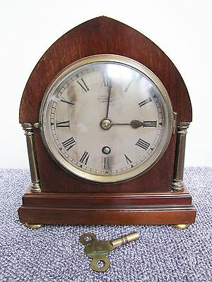 """Antique 2 column time only mantel clock with """"Russells LTD"""" early 1900s"""