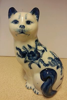 blue and white pottery cat decorated with flowers