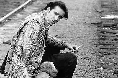 Wild At Heart Nicolas Cage 16X20 Poster seated smoking cigarette