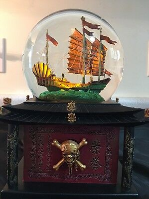 Disney Pirates of the Carribean At Worlds End Snow Globe very collectible W/Key
