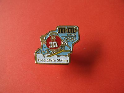 90's M&M Winter Olympic pin badge. VGC. Free Style Skiing.