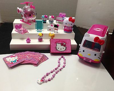 Hello Kitty Assorted Lot Of Ambulance, Helicopter, Figures, & More