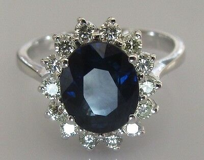 Secondhand 18ct White Gold Oval Blue Sapphire Multi Diamond Cluster Ring Size M.