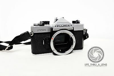 Fujifilm FUJICA STX-1 35mm SLR Film Camera Body Only with neck strap.