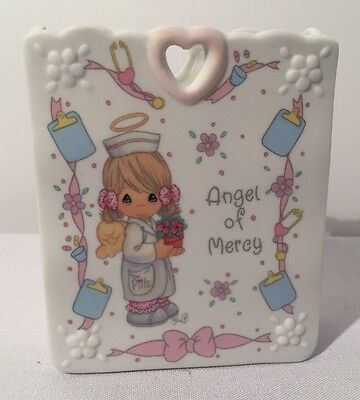 "Precious Moments Angel Of Mercy 1995,  3 3/4"" Tall, 3 1/4"" Wide, 1 1/2"" Deep"