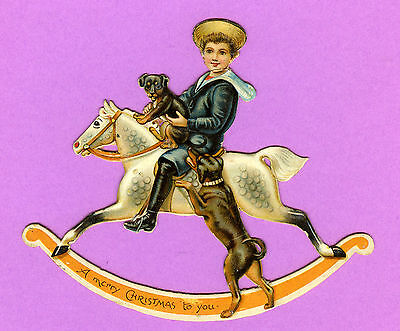 c1910 DIE-CUT NOVELTY CHRISTMAS GREETING CARD ~ BOY ON A ROCKING HORSE + DOGS