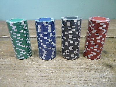100 suited poker chips / tokens - 25 x red / green / blue / black sealed in case