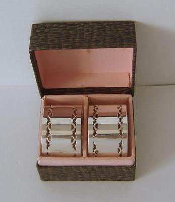 A Boxed Pair Of Vintage Silverplated Napkin Rings