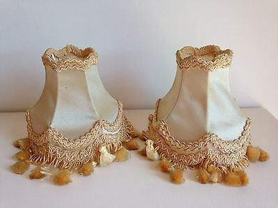 Pair of vintage pale yellow/beige clip-on light lampshades with tassel trim 1950
