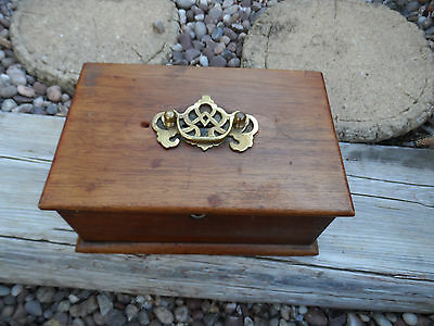 Vintage old wooden box with brass furnishing